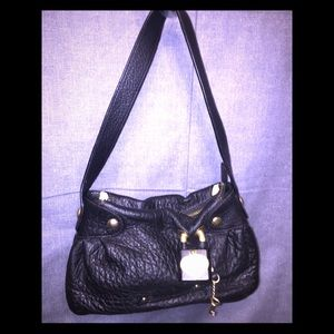 Juicy Couture's Genuine Leather Faux Elephant Bag